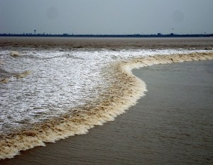 Tidal bore on the Qiantang river, China.