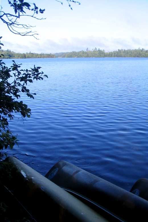 A morning view of Knife Lake over canoes